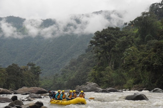 Rafting past misty mountains in Ecuador