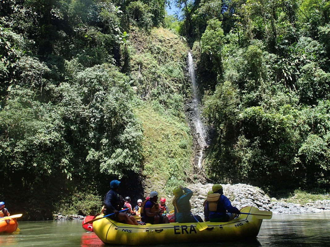 Another surprise waterfall for a rafting group in Ecuador