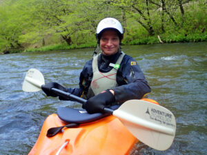 Rolling a kayak on the river